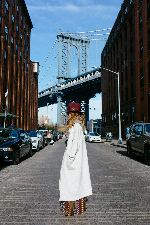 Whitney's Wonderland NYC Top Fashion Blogger wearing fedora burgundy hat, Oui coatigan and Abs by Allen Schwartz harvey pants in Manhattan Bridge