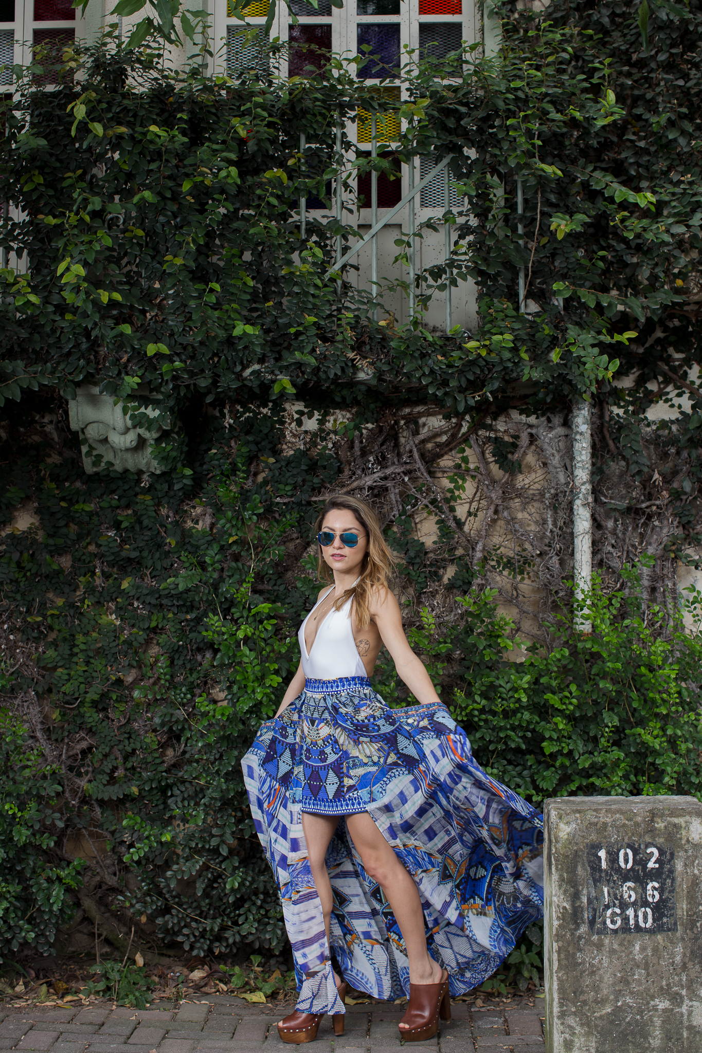 Whitney's Wonderland NYC Top Fashion Blogger wears Camilla silk digital printed skirt, American Apparel white bodysuit and RayBan blue mirrored sunglasses in Barrio Amon