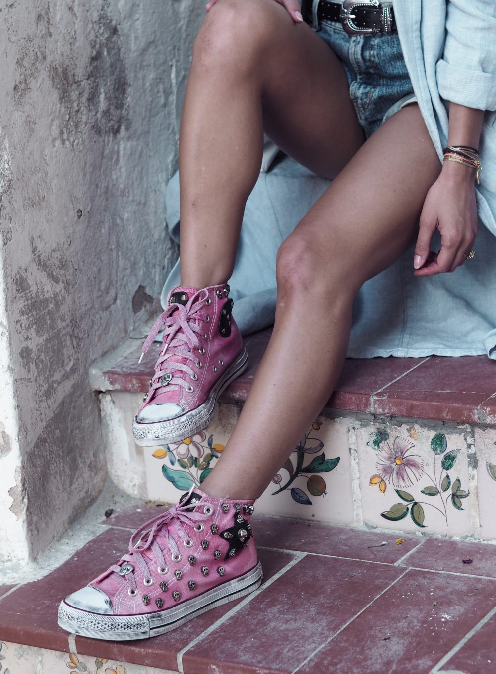 Whitney's Wonderland UK Top Fashion Blogger wears One Teaspoon bandit dehim shorts and pink converse in Dalt Vila, Ibiza