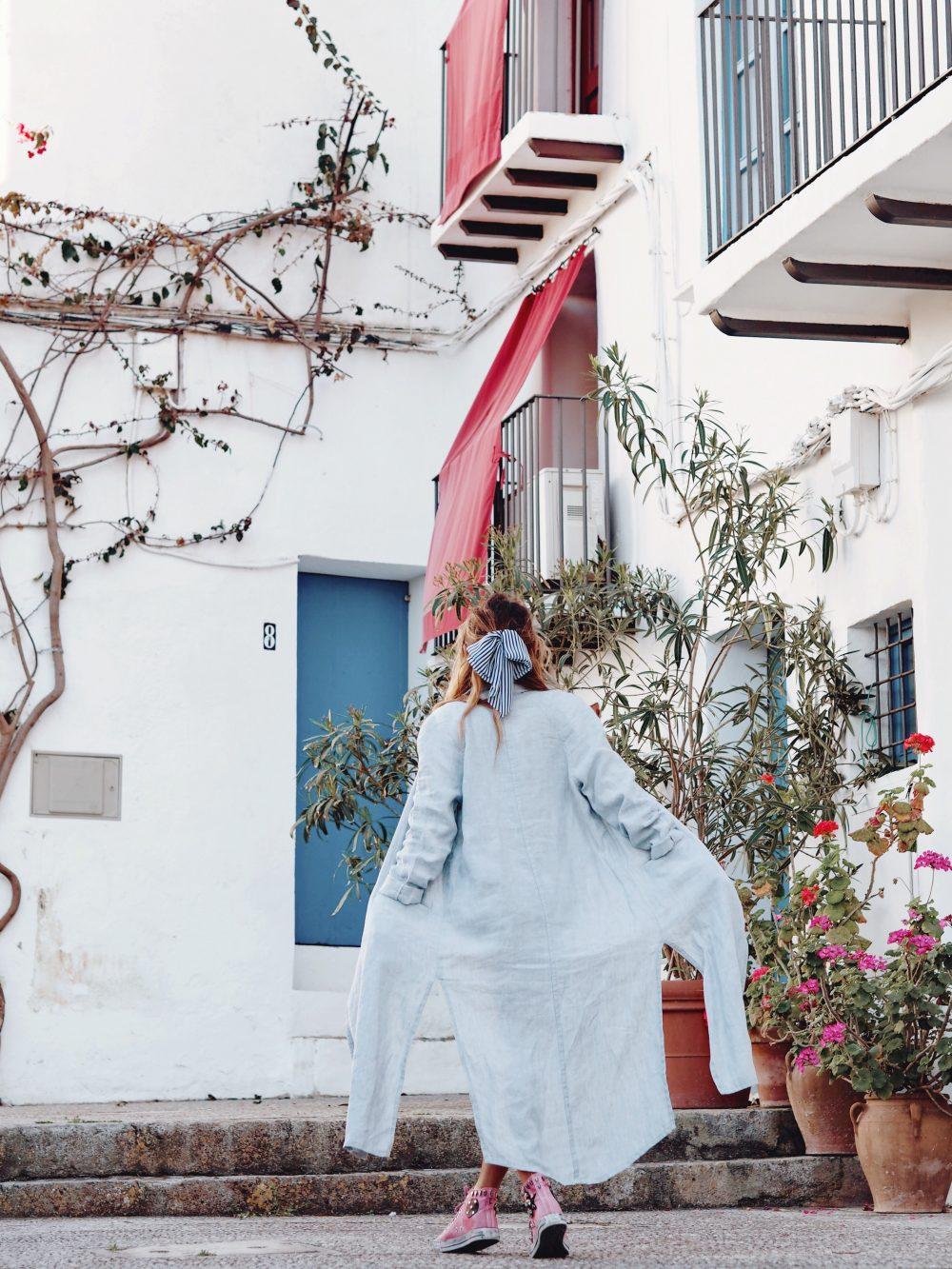 Whitney's Wonderland UK Top Fashion Blogger wears mango linen coat and pink converse in Dalt Vila, Ibiza