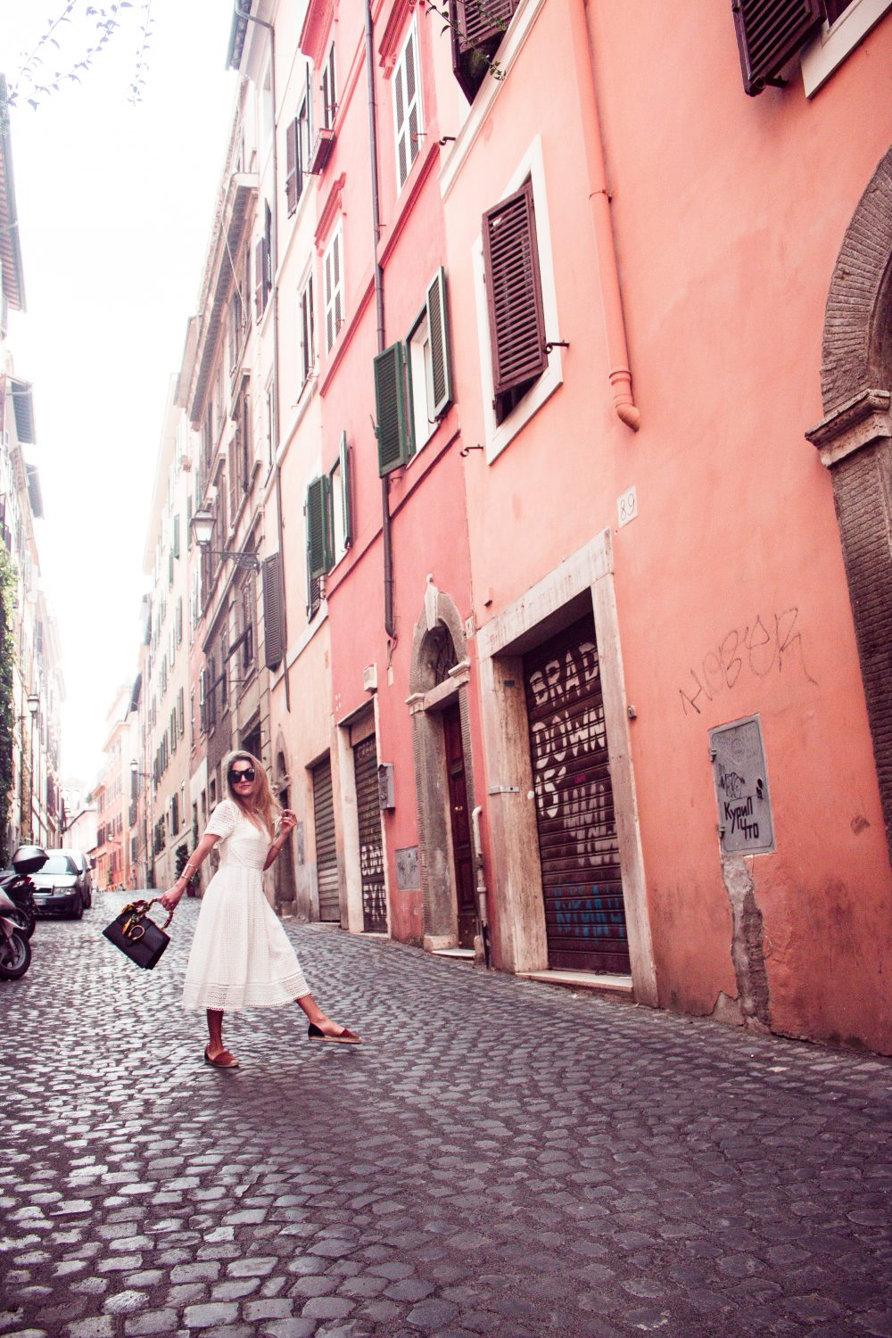 Whitney's Wonderland UK Top Luxury Fashion Blogger wears Boden white lace midi dress, Boden black and brown espadrilles and Gucci dionysus bag in Rome